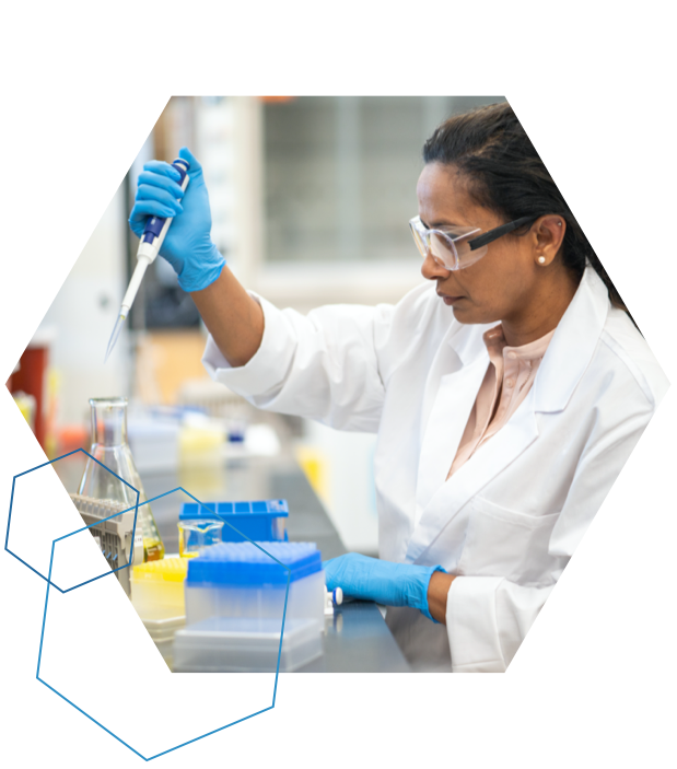 Woman scientist in a lab wearing gloves and googles